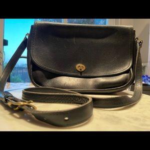 Vintage Coach black leather cross body saddle bag.
